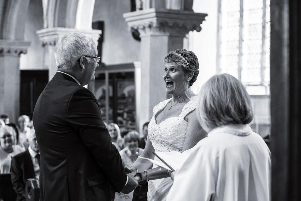 happy-bride-hedingham-castle